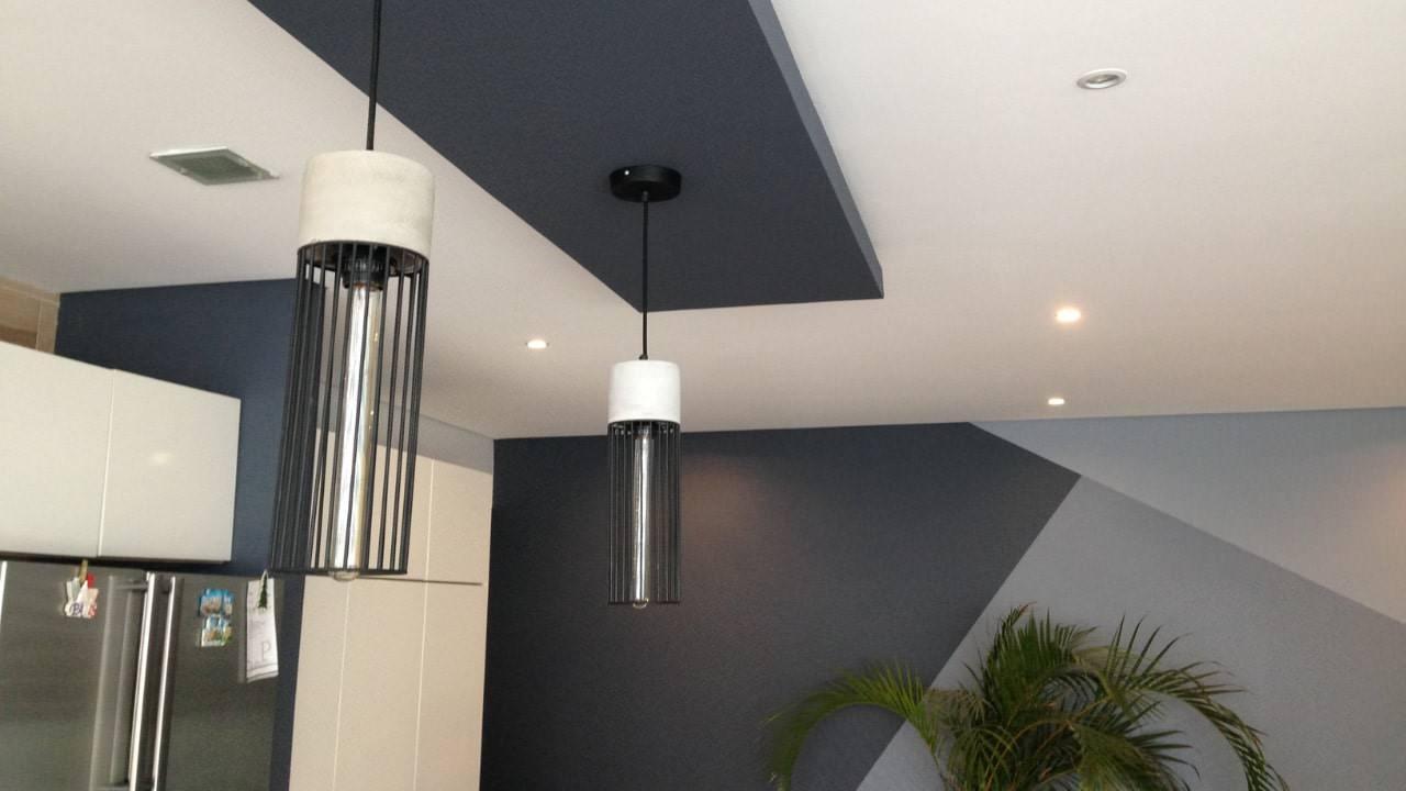 Plafon flotado lampara de concreto pintura triángulos residencial wtc